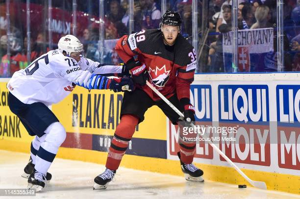 Brady Skjei of USA tackles Anthony Mantha of Canada during the 2019 IIHF Ice Hockey World Championship Slovakia group A game between Canada and...