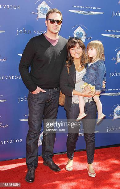 Brady Smith and actress Tiffani Thiessen with daughter Harper Smith arrive at The John Varvatos 10th Annual Stuart House Benefit held on March 10...