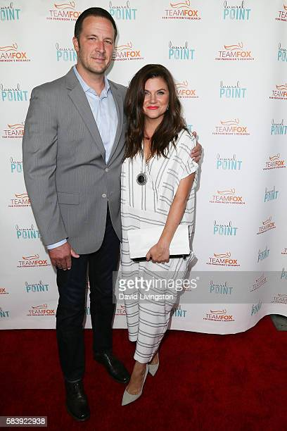 Brady Smith and Tiffani Thiessen arrive at Raising The Bar To End Parkinson's at Laurel Point on July 27 2016 in Studio City California