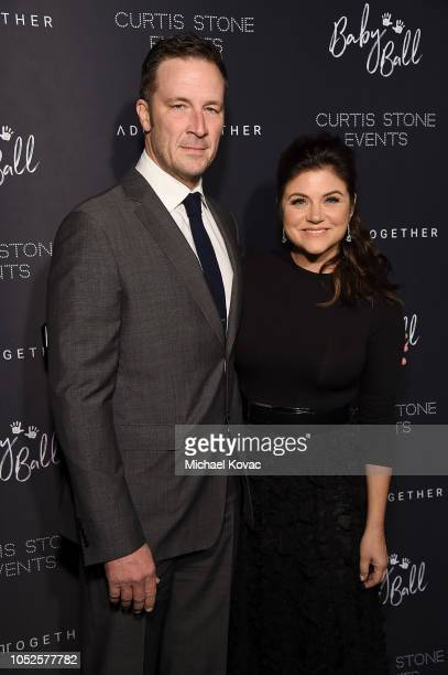 Brady Smith and Tiffani Thiessen attend the 4th Adopt Together Baby Ball Gala on October 19 2018 in Los Angeles California