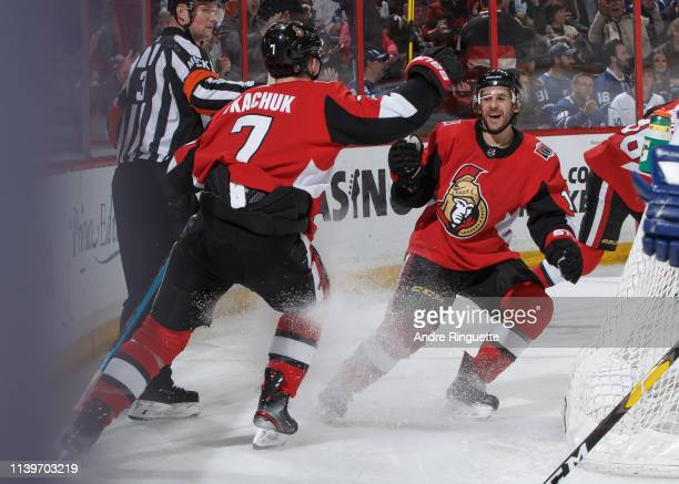 Brady Tkachuk and Brian Gibbons of the Ottawa Senators celebrate a third period goal against the Toronto Maple Leafs at Canadian Tire Centre on March...