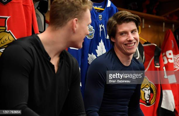Brady Tkachuk of the Ottawa Senators and Mitch Marner of the Toronto Maple Leafs share a laugh in the locker room prior the 2020 NHL All-Star Skills...