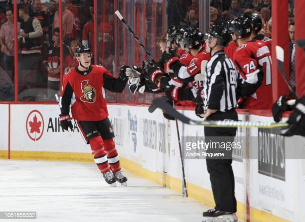 Brady Tkachuk of the Ottawa Senators celebrates his second period goal against the Philadelphia Flyers with teammates at the players bench at...