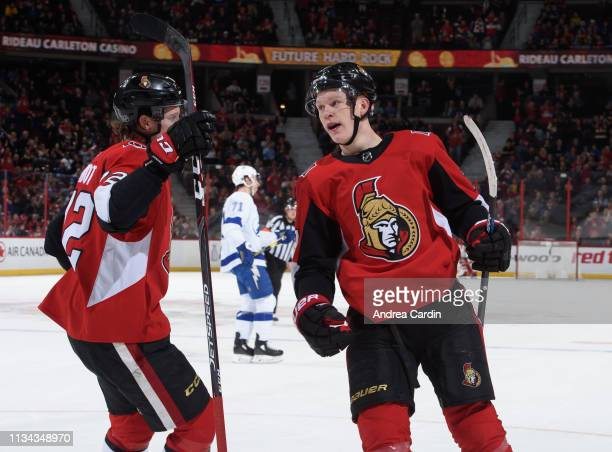 Brady Tkachuk of the Ottawa Senators celebrates with Thomas Chabot after scoring a first period goal on the Tampa Bay Lightning at Canadian Tire...