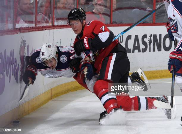 Brady Tkachuk of the Ottawa Senators collides with Alexandre Texier of the Columbus Blue Jackets at Canadian Tire Centre on April 6 2019 in Ottawa...