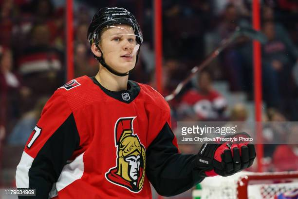 Brady Tkachuk of the Ottawa Senators holds the puck in his gove during a stoppage in play in a game against the New York Rangers at Canadian Tire...