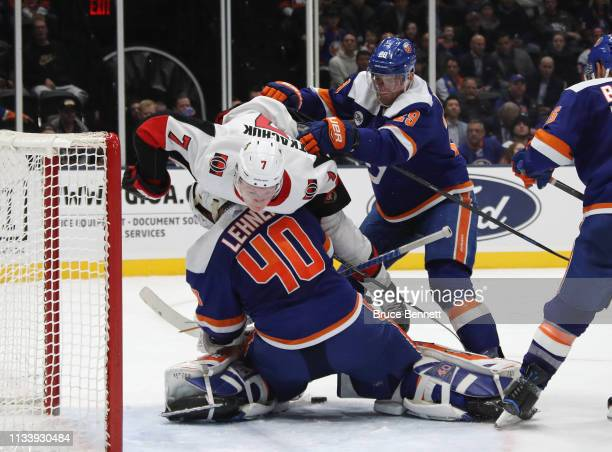 Brady Tkachuk of the Ottawa Senators is checked over Robin Lehner of the New York Islanders as the Senators tie the score at 44 in the third period...