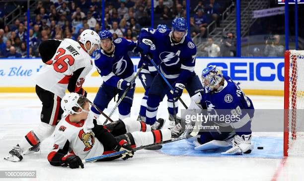Brady Tkachuk of the Ottawa Senators scores a goal on Andrei Vasilevskiy of the Tampa Bay Lightning during a game at Amalie Arena on November 10 2018...