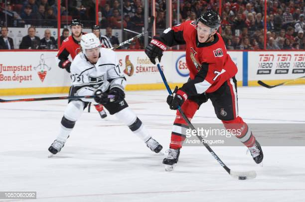 Brady Tkachuk of the Ottawa Senators shoots the puck against pressure from Tyler Toffoli of the Los Angeles Kings at Canadian Tire Centre on October...