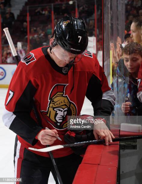 Brady Tkachuk of the Ottawa Senators signs a stick for a fan during warmup prior to a game against the Columbus Blue Jackets at Canadian Tire Centre...