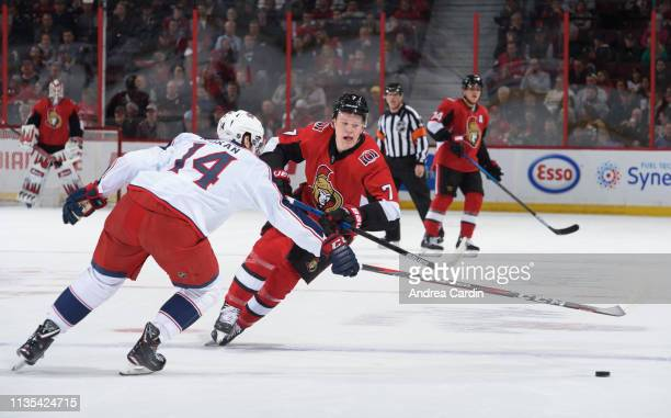 Brady Tkachuk of the Ottawa Senators stickhandles the puck against Dean Kukan of the Columbus Blue Jackets at Canadian Tire Centre on April 6 2019 in...
