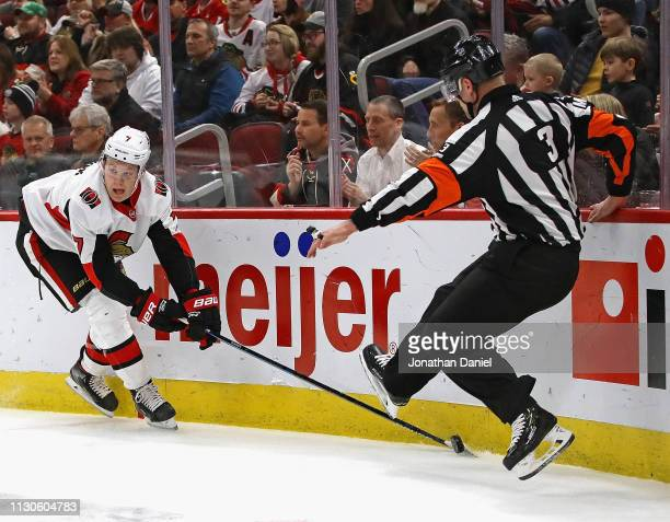 Brady Tkachuk of the Ottawa Senators tries to get off a pass between the legs of referee Chris Schlenker against the Chicago Blackhawks at the United...
