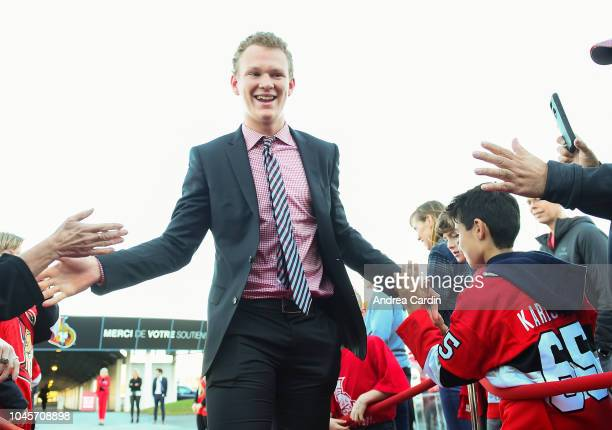 Brady Tkachuk of the Ottawa Senators walks the red carpet ahead of an NHL game against the Chicago Blackhawks at Canadian Tire Centre on October 4...