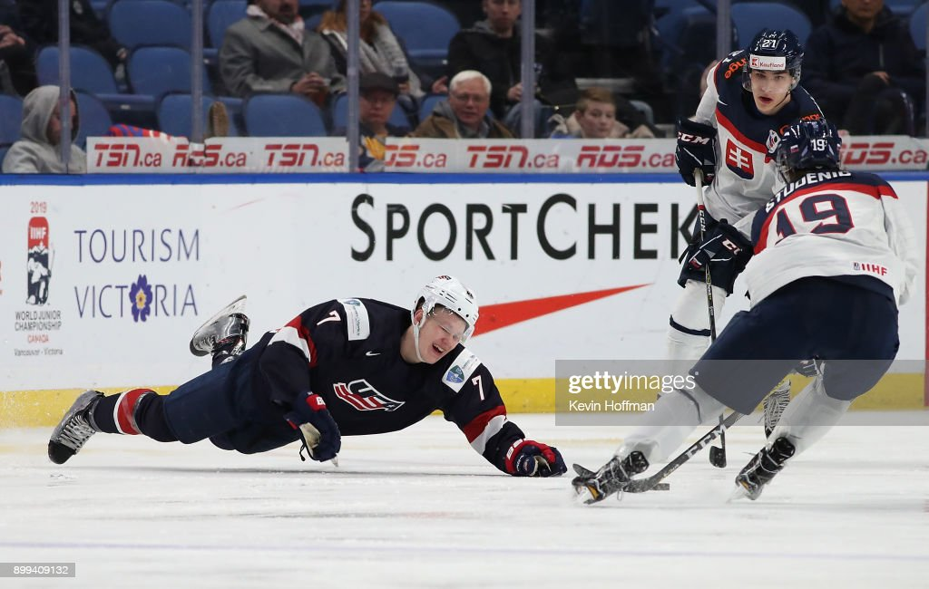 Brady Tkachuk #7 of United States gets tripped up as Marian Studenic #19 of Slovakia takes the puck in the second period during the IIHF World Junior Championship at KeyBank Center on December 28, 2017 in Buffalo, New York.