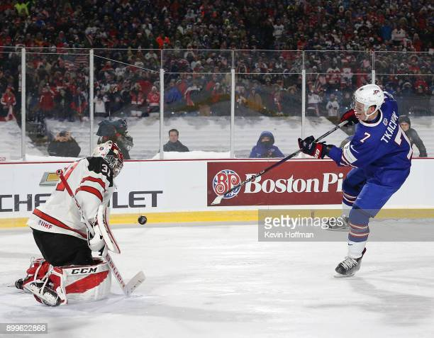 Brady Tkachuk of United States scores a goal against Carter Hart of Canada in the shootout against Canada during the IIHF World Junior Championship...