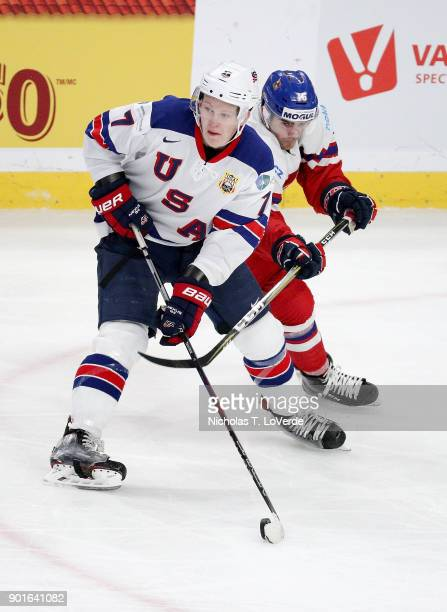 Brady Tkachuk of United States skates the puck with Martin Kaut of Czech Republic applies defensive pressure during the second period of play in the...