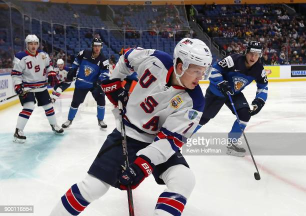 Brady Tkachuk of United States skates with the puck as Eeli Tolvanen of Finland pursues in the first period during the IIHF World Junior Championship...