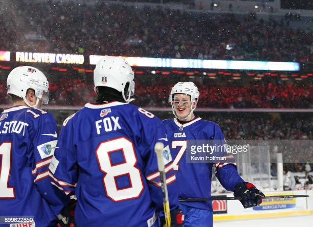 Brady Tkachuk of United States with Casey Mittelstadt and Adam Fox before the start of the overtime period during the IIHF World Junior Championship...