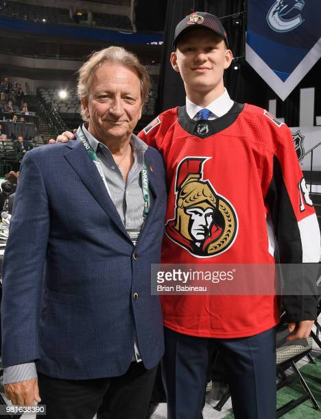 Brady Tkachuk poses for a photo with Ottawa Senators Eugene Melnyk after being selected fourth overall by the Ottawa Senators during the first round...
