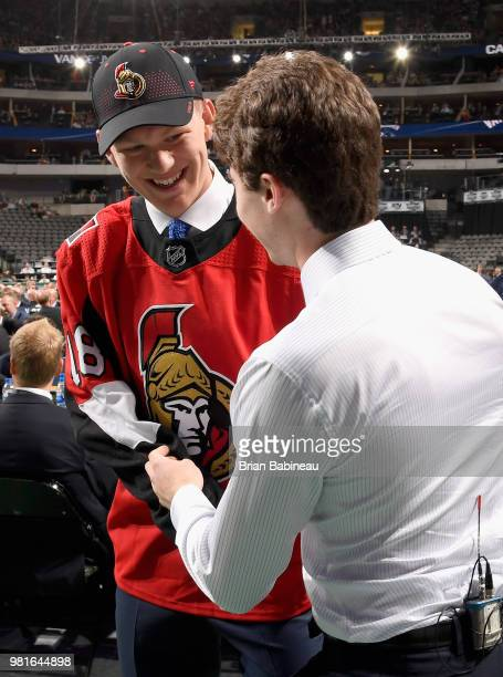 Brady Tkachuk selected fourth overall by the Ottawa Senators shakes the hand of Quinton Hughes after Hughes was selected seventh overall by the...