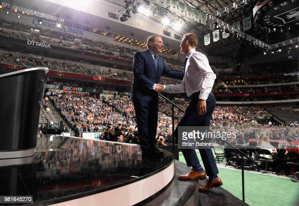 Brady Tkachuk shakes the hand of NHL Commissioner Gary Bettman after being selected fourth overall by the Ottawa Senators during the first round of...