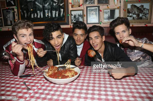 Brady Tutton Drew Ramos Sergio Calderon Chance Perez and Michael Conor of In Real Life the grand prize winner of ABC's Boy Band visit Planet...