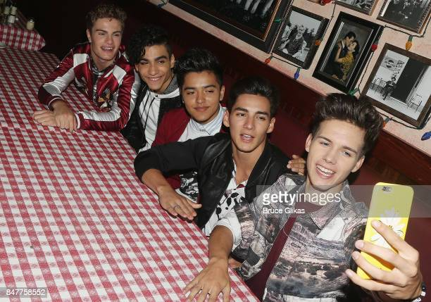 Brady Tutton Drew Ramos Sergio Calderon Chance Perez and Michael Conor of 'In Real Life' the grand prize winner of ABC's 'Boy Band' pose for a...