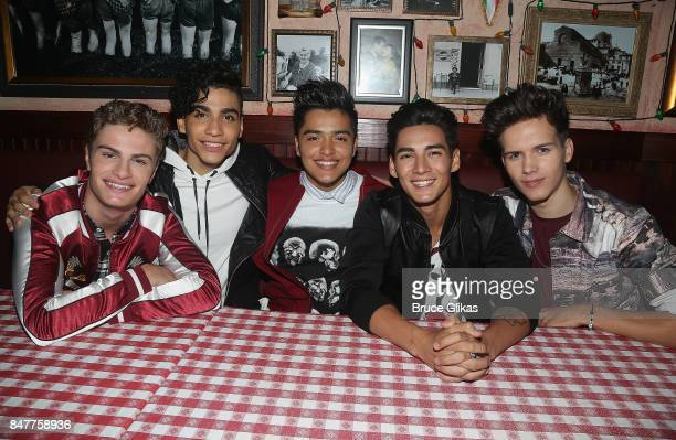 Brady Tutton Drew Ramos Sergio Calderon Chance Perez and Michael Conor of 'In Real Life' the grand prize winner of ABC's 'Boy Band' visit Buca di...