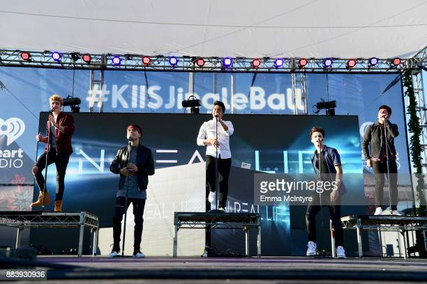Brady Tutton Drew Ramos Sergio Calderon Michael Conor and Chance Perez of In Real Life perform on stage at 1027 KIIS FM's Jingle Ball Village at KIIS...