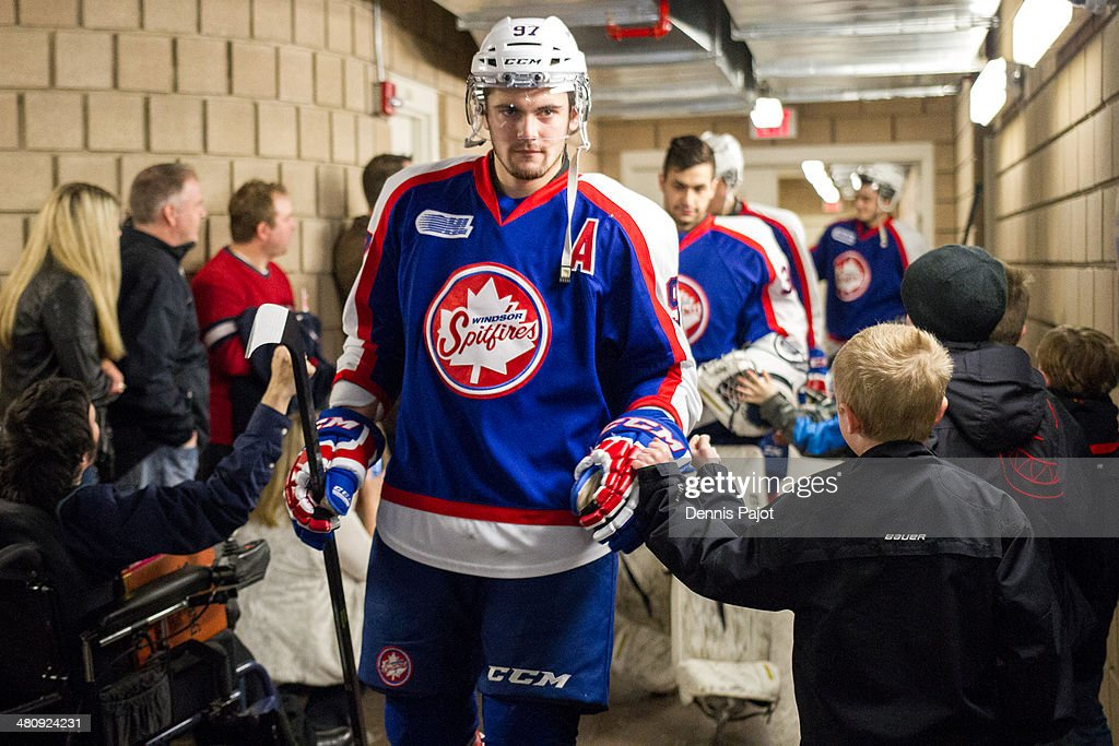 Brady Vail #97 of the Windsor Spitfires greets fans before a game against the Sault Ste. Marie Greyhounds on March 9, 2014 at the WFCU Centre in Windsor, Ontario, Canada.