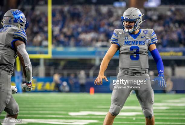 Brady White of the Memphis Tigers reacts after a touchdown during the Goodyear Cotton Bowl Classic at ATT Stadium on December 28 2019 in Arlington...