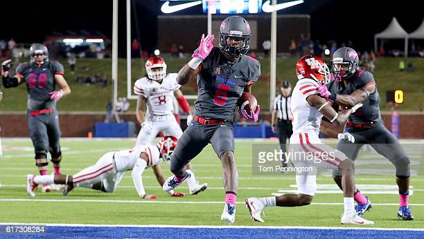 Braeden West of the Southern Methodist Mustangs scores a touchdown against Terrell Williams of the Houston Cougars in the fourth quarter at Gerald J....