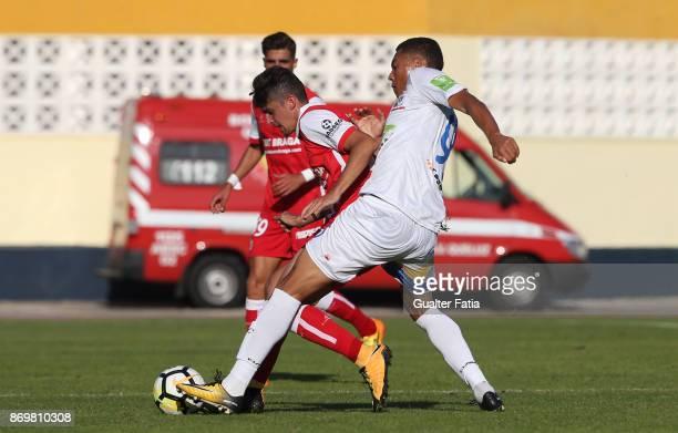 Braga B forward Francisco Trincao from Portugal with Real SC forward Carlos Vinícius from Brazil in action during the Segunda Liga match between Real...