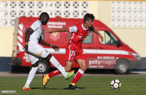 Braga B forward Francisco Trincao from Portugal with Real SC forward Abou Toure from Senegal in action during the Segunda Liga match between Real SC...