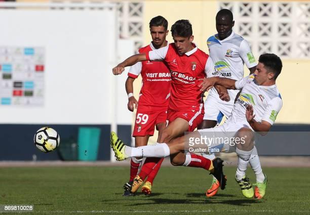 Braga B forward Francisco Trincao from Portugal with Real SC midfielder Gustavo Cazonatti from Brazil in action during the Segunda Liga match between...