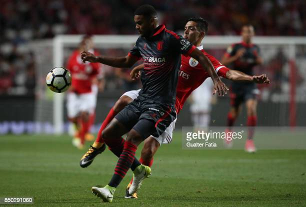 Braga defender Bruno Viana from Brazil with SL Benfica forward Raul Jimenez from Mexico in action during the Portuguese League Cup match between SL...