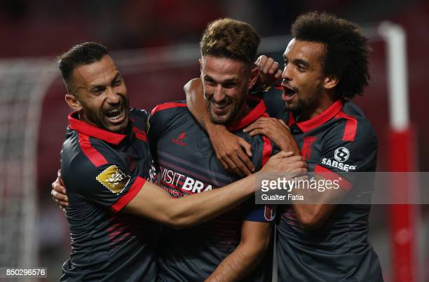 Braga defender Ricardo Ferreira from Portugal celebrates with teammates after scoring a goal during the Portuguese League Cup match between SL...
