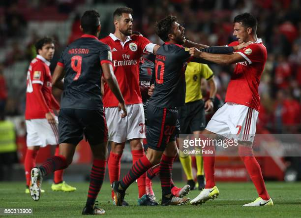 Braga forward Paulinho from Portugal and SL Benfica midfielder Andreas Samaris from Greece grab each other during the Portuguese League Cup match...