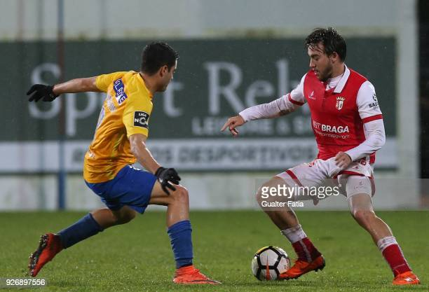 Braga midfielder Andre Horta from Portugal with GD Estoril Praia midfielder Eduardo Teixeira from Brazil in action during the Primeira Liga match...