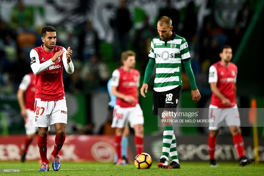 Braga's Brazilian defender Marcelo Goiano (L) celebrates teammate Sporting Braga's forward Wilson Eduardo's goal during the Portuguese league football match Sporting CP vs Sporting Braga at the Jose Alvalade stadium in Lisbon on December 18, 2016. / AFP / PATRICIA