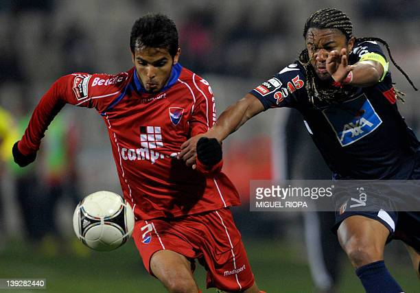 SC Braga's Brazilian forward Alan Silva vies with SC Braga's Brazilian defender Rodrigo Galo during their Portuguese super league football match at...