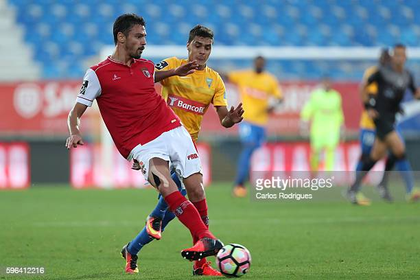 Braga's defender Andre Pinto from Portugal vies with Estoril's forward Alisson Farias from Brazil during the match between Estoril Praia SAD and SC...
