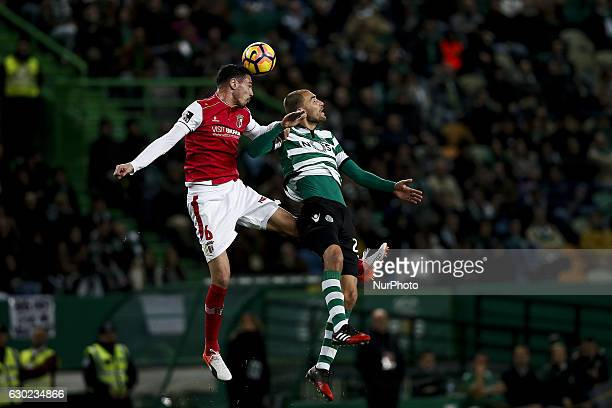 Braga's defender Andre Pinto vies for the ball with Sporting's forward Bas Dost during Premier League 2016/17 match between Sporting CP vs Vitoria FC...