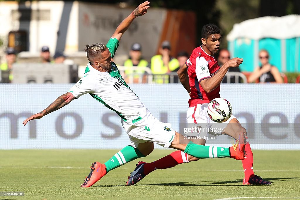 Braga's defender Djavan tres to pass trough Sporting's defender Miguel Lopes during the Portuguese Cup Final between Sporting CP and SC Braga at Estadio Nacional on May 31, 2015 in Oeiras, Portugal.