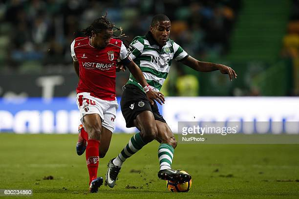 Braga's forward Alan vies for the ball with Sporting's midfielder Marvin Zeegelaar during Premier League 2016/17 match between Sporting CP vs Vitoria...