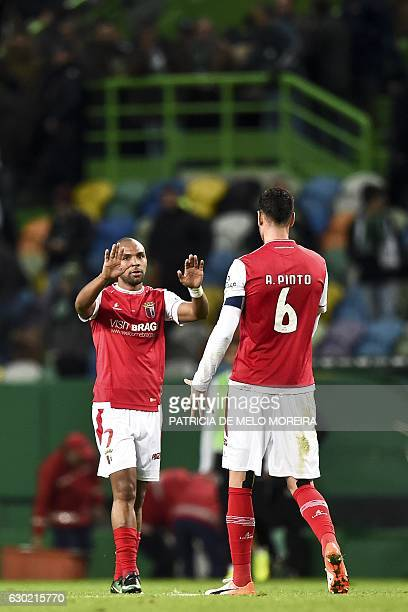 Braga's forward Wilson Eduardo celebrates with teammate Braga's defender Andre Pinto at the end of the Portuguese league football match Sporting CP...