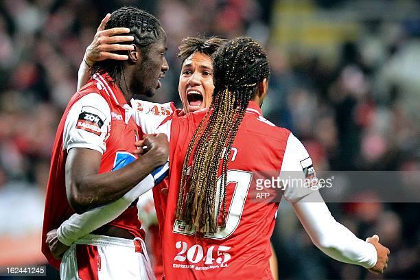 Braga's GuineaBissauan forward Ederzito Lopes 'Eder' celebrates with his teammates Brazilian midfielder Jose Marcio da Costa 'Mossoro' and Brazilian...