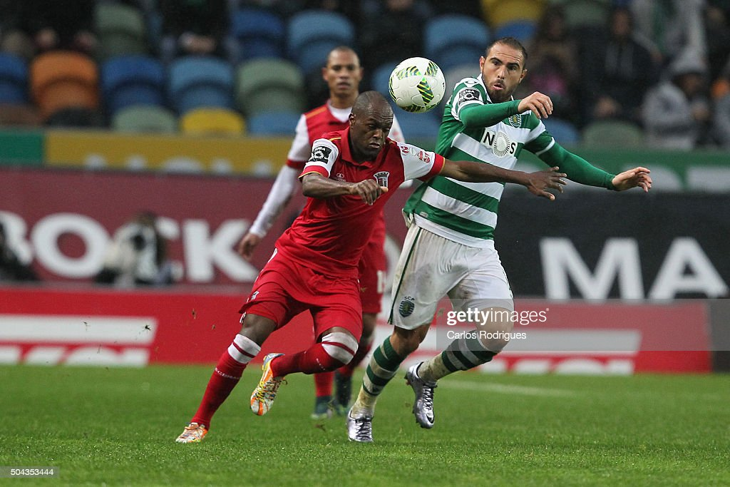 Braga's midfielder Luiz Carlos vies with Sporting's forward Bruno Cesar during the match between Sporting CP and SC Braga for the Portuguese Primeira Liga at Jose Alvalade Stadium on September 21 2015 in Lisbon, Portugal.