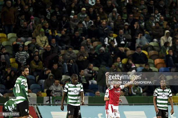 Braga's midfielder Miguel Xeka celebrates teammate Sporting Braga's forward Wilson Eduardo's goal during the Portuguese league football match...