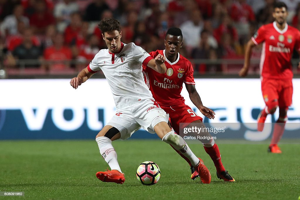 Braga's midfielder Nicola Vukcevic from Montenegro (L) vies with SL Benfica's defender Nelson Semedo during the match between SL Benfica and SC Braga for the Portuguese Primeira Liga at Estadio da Luz on September 19, 2016 in Lisbon, Portugal.